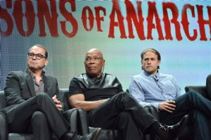 "From left, Creator Kurt Sutter, Director Paris Barclay and actor Charlie Hunnam speak on stage during the ""Sons of Anarchy"" panel at the The FX 2014 Summer TCA Tour"