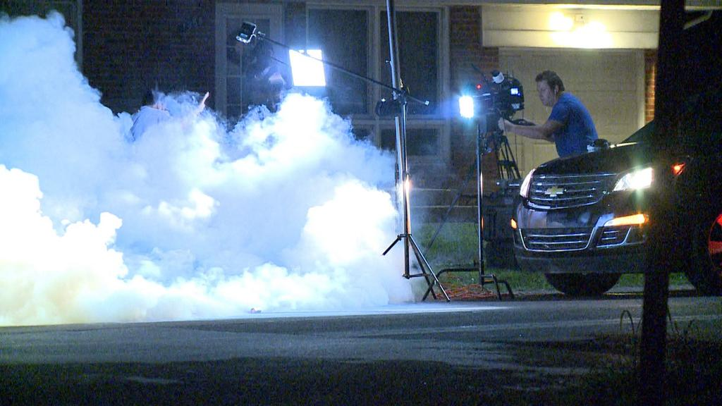 KSDK caught this image of the Ferguson, Mo. police dept. throwing tear gas at another TV crew. (KSDK.com)