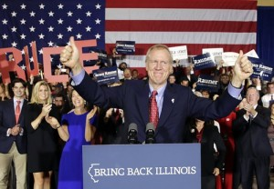 Rauner wins. (Charles Rex Abrogast/AP Photo)