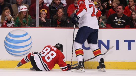 Patrick Kane goes down. (AP)