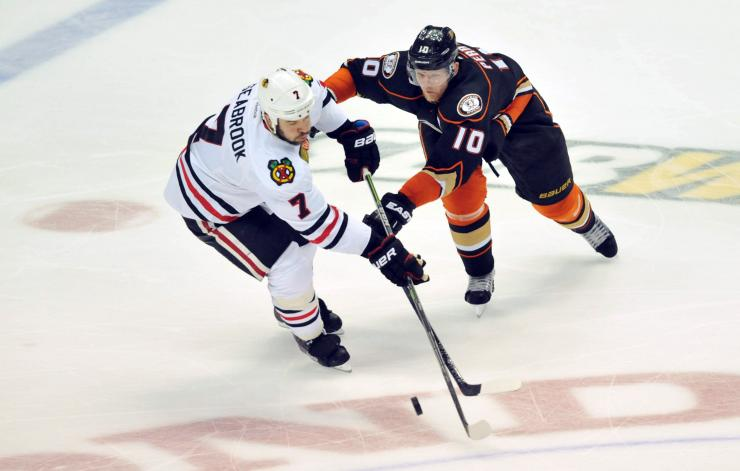 Brent Seabrook (left) and Corey Perry. (intimes.com)