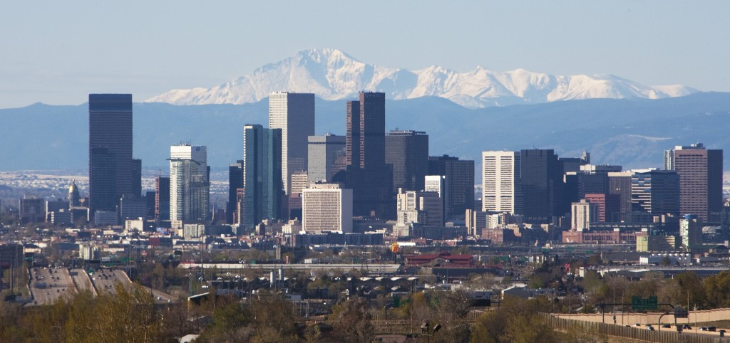 The Colorado State capitol dome in real Colorado gold gilding stands on the left in this skyline shot of downtown with the distant Pike's Peak mountain looming in the background in Denver on April 30, 2011.
