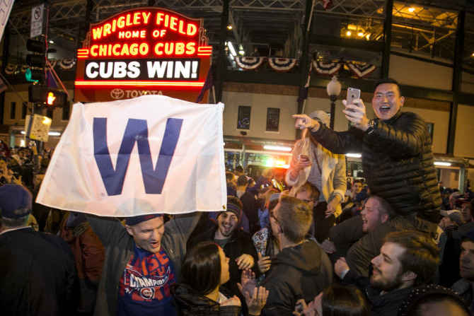 Fans celebrate as the Chicago Cubs beat the Cleveland Indians in Game 5 of the World Series at Wrigley Field, Sunday night, Oct. 30, 2016. | Ashlee Rezin/Sun-Times